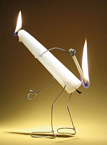 A candle burns itself at both ends - a funny photo