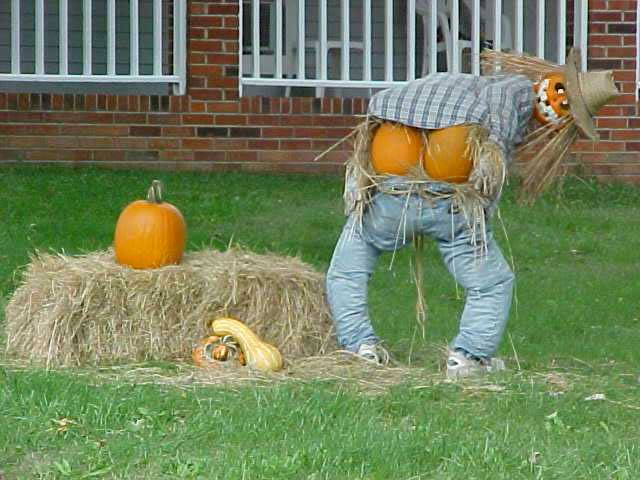 Scarecrow mooning people in the street