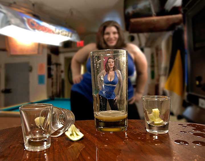 Looking through empty glass shows beautiful woman slimmed down from huge woman