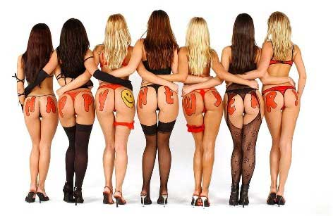 Women's behinds each with a new year greeting