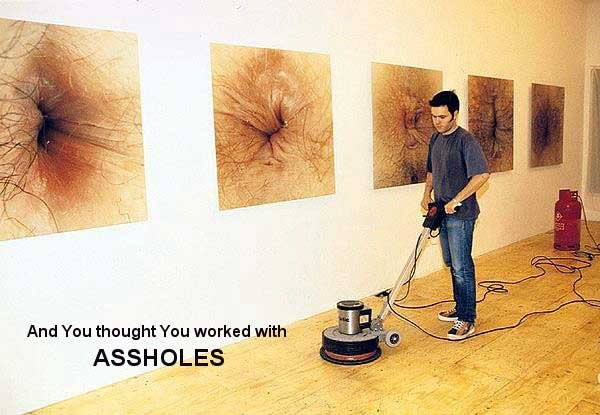 man working in a photo gallery of assholes